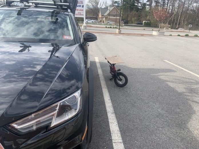 Bikes left next to car